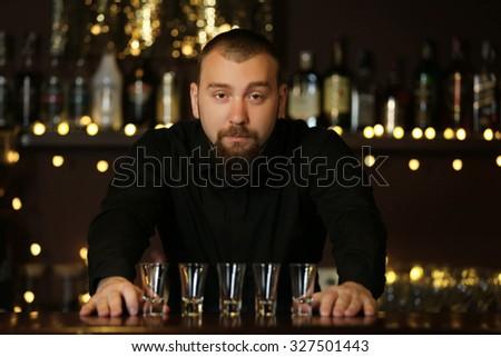 Portrait of handsome bartender at  work - stock photo