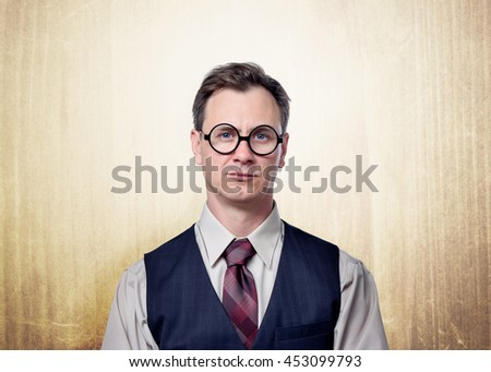 Portrait of handsome business man in glasses on background - stock photo