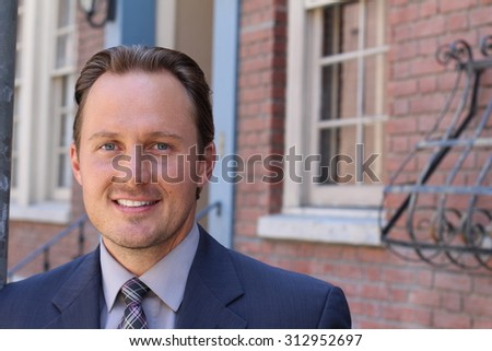 Portrait of handsome clean cut businessman in London - stock photo