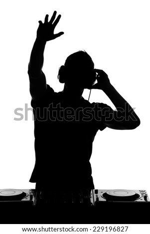 Portrait of handsome dj is playing club music and looking at the camera. - stock photo