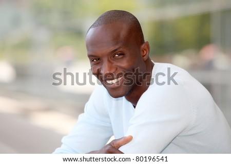 Portrait of handsome ethnic man - stock photo