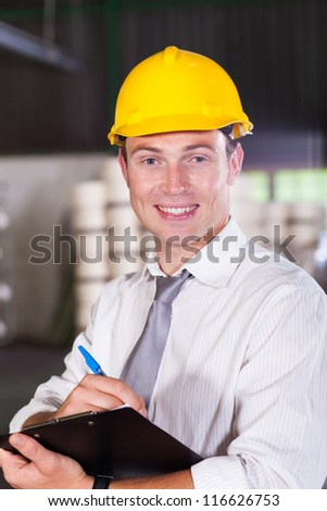 portrait of handsome factory manager - stock photo