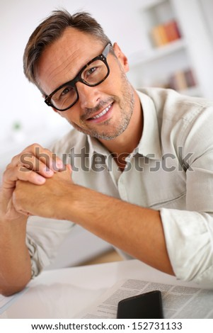 Portrait of handsome guy with eyeglasses - stock photo