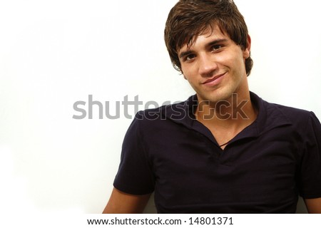 Portrait of handsome hispanic teenager smiling - isolated - stock photo