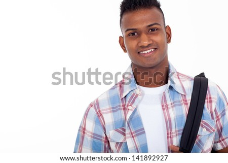portrait of handsome indian teenage high school student on white background - stock photo