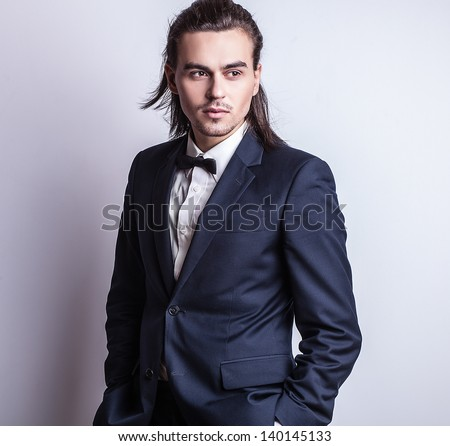 Portrait of handsome long-haired stylish man. - stock photo