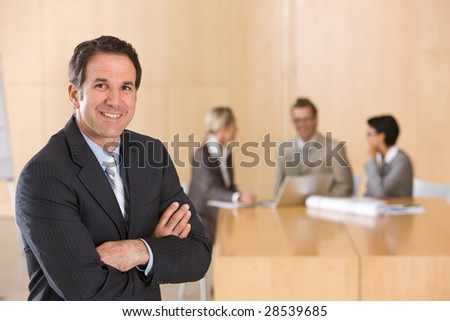 portrait of handsome male executive - stock photo