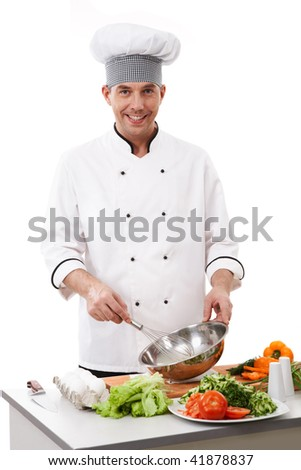 Portrait of handsome man in cook uniform smiling at camera during work - stock photo