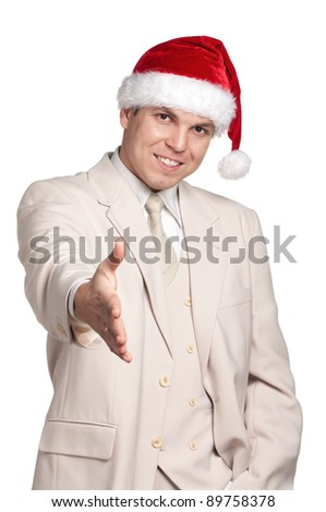 Portrait of handsome man in santa hat on white background - stock photo