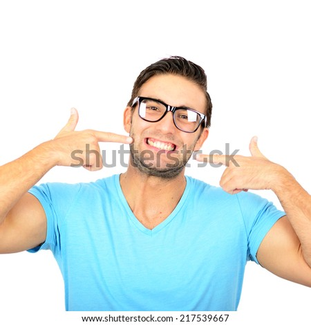 Portrait of handsome man poitning at his healthy smile or teeth against white background - stock photo