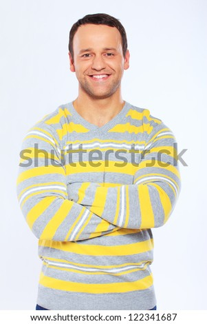 Portrait of handsome man posing in studio - stock photo
