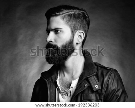 Portrait of handsome man with beard. Close-up - stock photo