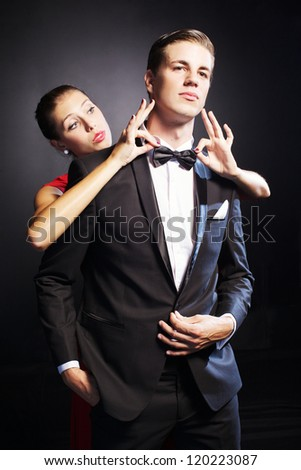 Portrait of handsome man  with beautiful woman near  at him - stock photo