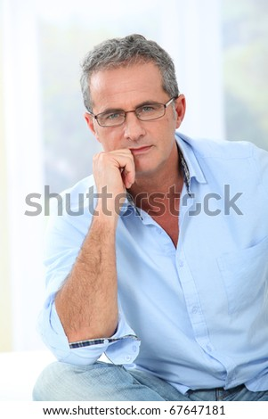 Portrait of handsome man with eyeglasses - stock photo