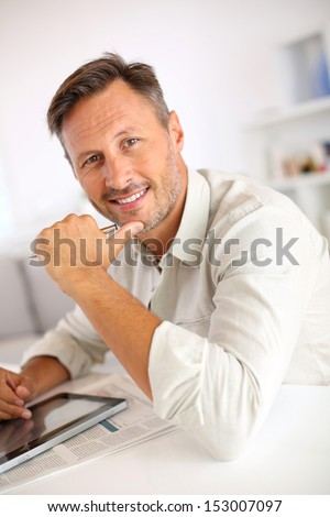 Portrait of handsome mature man - stock photo