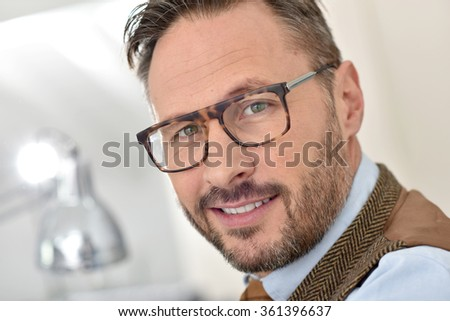 Portrait of handsome middle-aged man with eyeglasses - stock photo