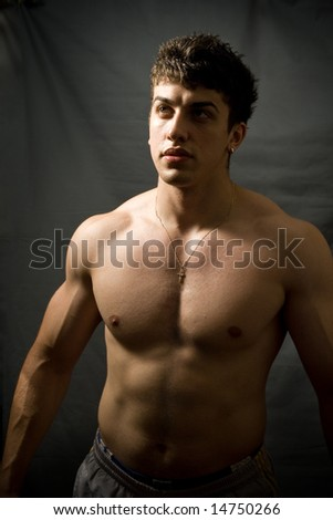 Portrait of handsome muscular man - stock photo