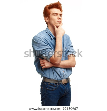 Portrait of handsome red haired young man in casual clothes standing over white background. - stock photo
