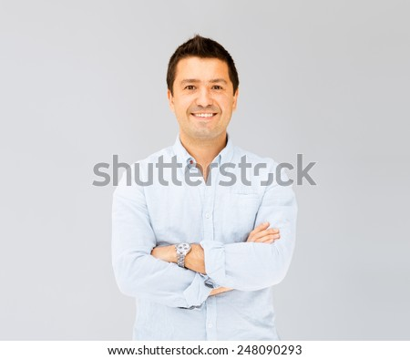portrait of handsome smiling man in casual shirt - stock photo