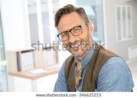 Portrait of handsome stylish guy with eyeglasses - stock photo