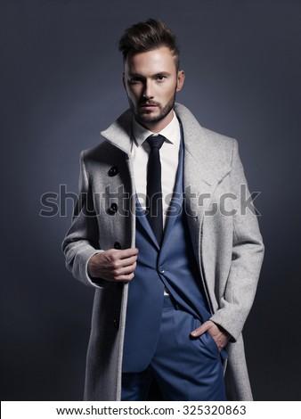 Portrait of handsome stylish man in elegant autumn coat - stock photo