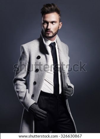 Portrait of handsome stylish man in elegant autumn coat - stock photo