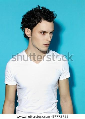 Portrait of handsome stylish man on blue background - stock photo