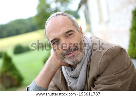 Portrait of handsome 50-year-old man - stock photo