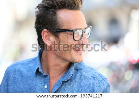 Portrait of handsome 40 year old man with eyeglasses - stock photo