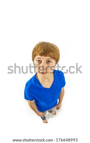 portrait of handsome young boy in studio in wideangle perspective - stock photo