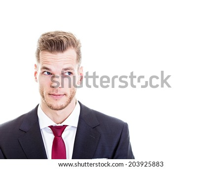 Portrait of handsome young businessman looking sideways in suit, isolated on white. - stock photo