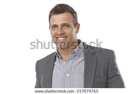 Portrait of handsome young businessman smiling happy. - stock photo