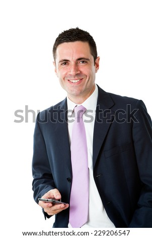 Portrait of Handsome young businessman wearing suit standing with smart phone.Isolated on white background. - stock photo
