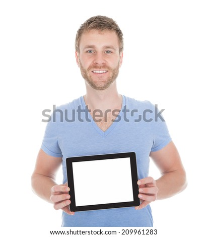 Portrait of handsome young man displaying digital tablet over white background - stock photo