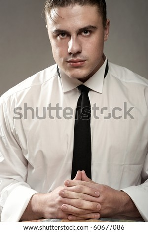 Portrait of handsome young man in white shirt - stock photo