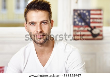 Portrait of handsome young man looking at camera. - stock photo