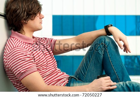 Portrait of handsome young man looking at the window - stock photo