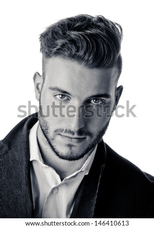 Portrait of handsome young man looking in camera, black and white shot - stock photo