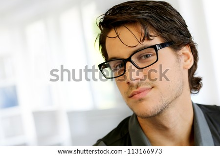 Portrait of handsome young man with glasses - stock photo