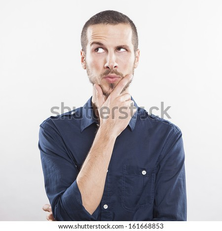 Portrait of handsome young thoughtful man isolated over white background - stock photo