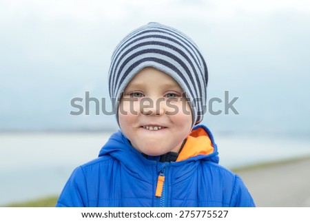 Portrait of happiness child outdoor. - stock photo
