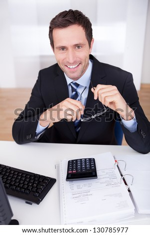 Portrait Of Happy Accountant At Workplace In The Office - stock photo