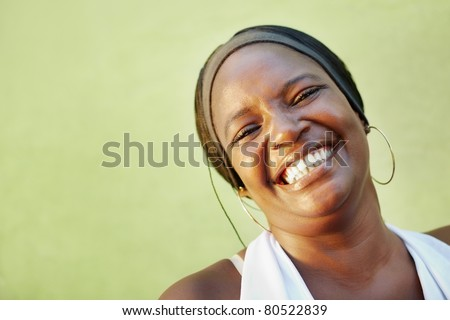 portrait of happy african adult woman looking at camera and smiling. Horizontal shape, copy space - stock photo