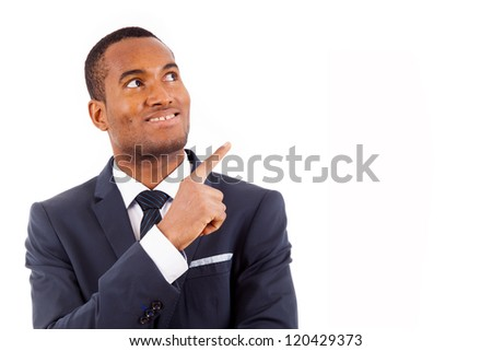Portrait of happy African American businessman pointing at copy space against white background - stock photo