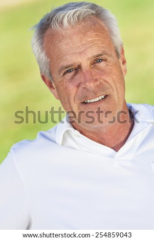 Portrait of happy and healthy senior man outside smiling and happy - stock photo