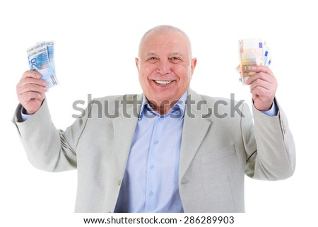 Portrait of happy and white teeth smile senior old business man holds euro money in raised hands up, dressed suit and blue shirt, isolated on white background. Human emotions and facial expressions - stock photo