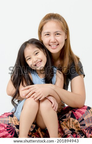 Portrait of happy Asian daughter and mother - stock photo