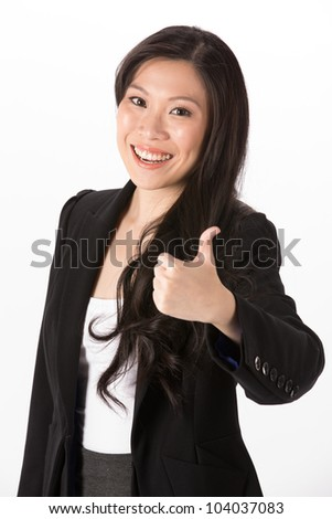 Portrait of happy Asian woman with her thumb pointing up.  Isolated on a white background. - stock photo