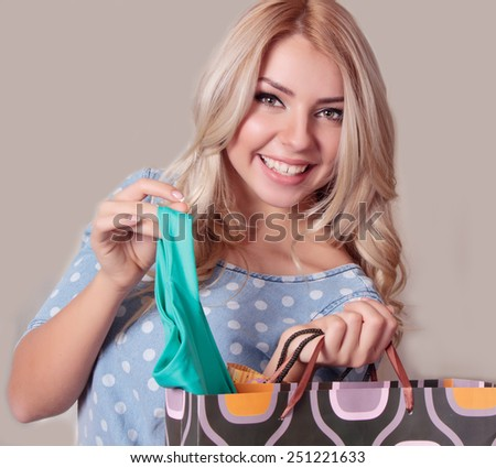 Portrait of happy attractive young women with shopping bags - stock photo