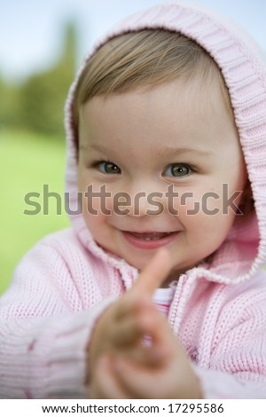 portrait of happy baby girl in park - stock photo